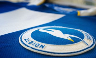 Brighton & Hove Albion football shirt & badge